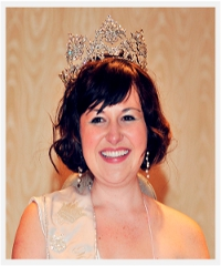 A smiling woman donned with a diadem  (by courtesy of Miss Wheelchair America)