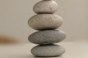 Four flat stones on top of each other to signify balance.