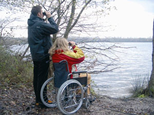 couple in wheelchair looking to the lake trail in the wood with wheelchair  (Picture: Eifel barrierefrei)