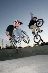 A boy on a wheelchair and another boy on a BMX bike are doing tricks in a skate park (Barry Bland/courtesy by aaronfotheringham.com)