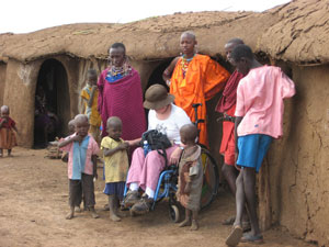 Wheelchair user with local people (Picture: GoAfrica Safaris)