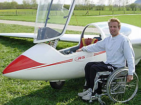 Martin Cotting sitting in his wheelchair in front of his glider plane (Picture: Martin Cotting)